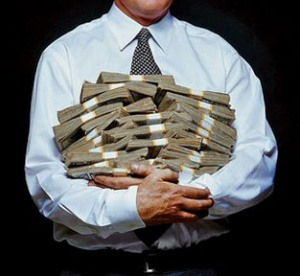 banker-holding-armful-of-money1